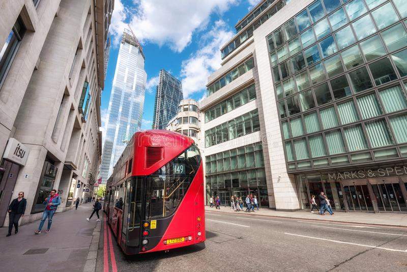 London, England - May 12, 2019: London`s iconic red double-decker bus with awesome modern skyscrapers architecture in. City stock images