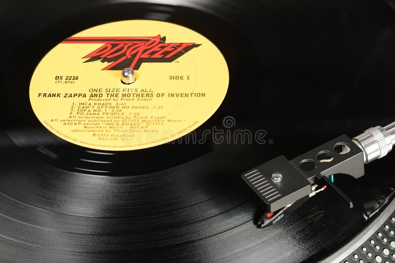 LONDON, ENGLAND - MAY 08, 2019: Vintage vinyl record with Discreet label played on turntable with audiophile Ortofon cartridge. LONDON, ENGLAND - MAY 08, 2019 royalty free stock images