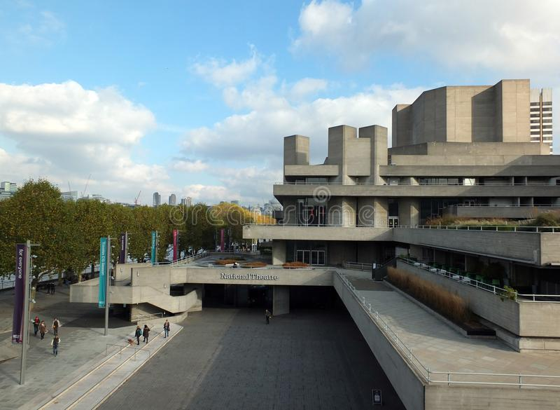 People walking along the concourse of the royal national theatre in London and on the pedestrian south bank of the river thames. London, England - November 04 royalty free stock photo