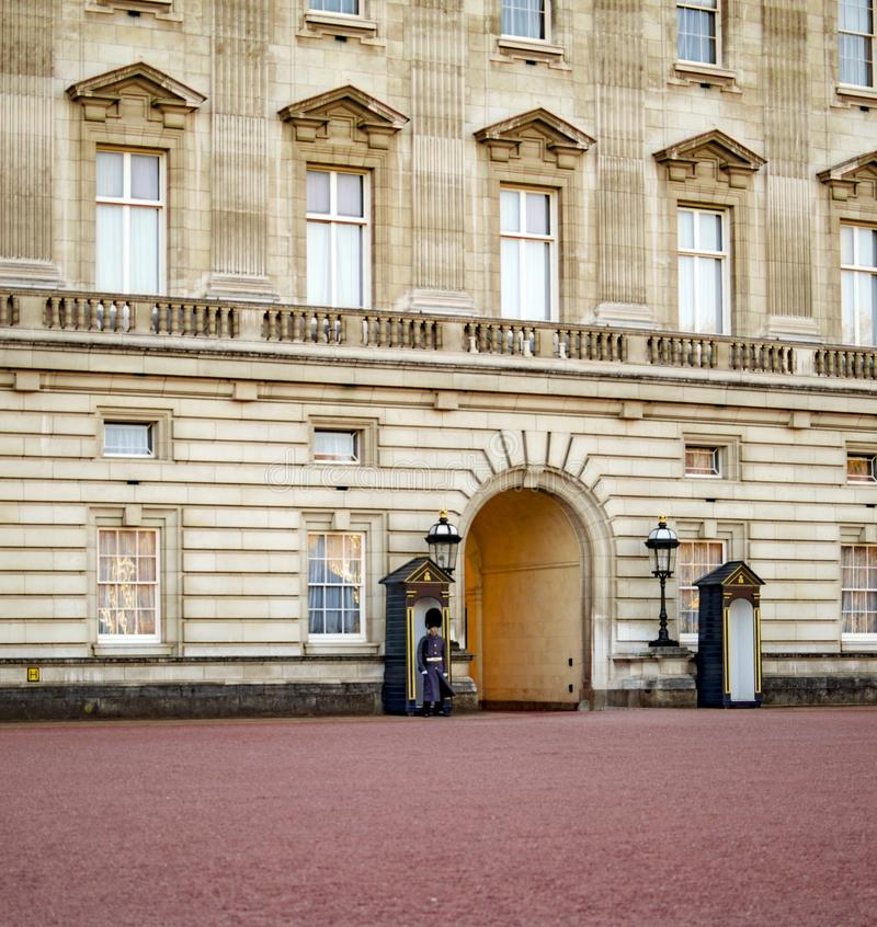 London, England - November 18, 2018: Royal guards at Buckingham palace for protection and tradition stock image