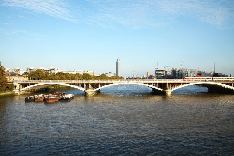 Battersea bridge scene. LONDON ENGLAND -OCT 11 : Atmosphere of battersea railway bridge where across the river thames between battersea and chelsea represent stock photo