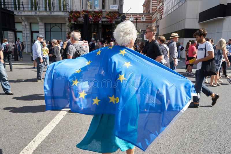 London, England. 08/31/2019. Old lady carrying a European flag behind her back in the Parliament suspension protest. Brexit stock photography