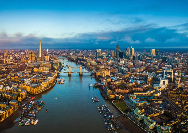 London, England - Panoramic aerial skyline view of London including Tower Bridge with red double-decker bus stock image