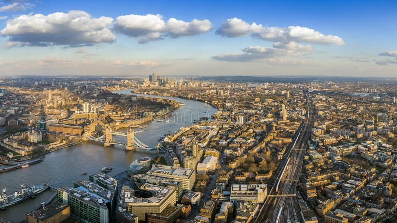 London, England - Panoramic aerial view of London with the famous Tower and Tower Bridge and skyscrapesr of Canary Wharf stock images