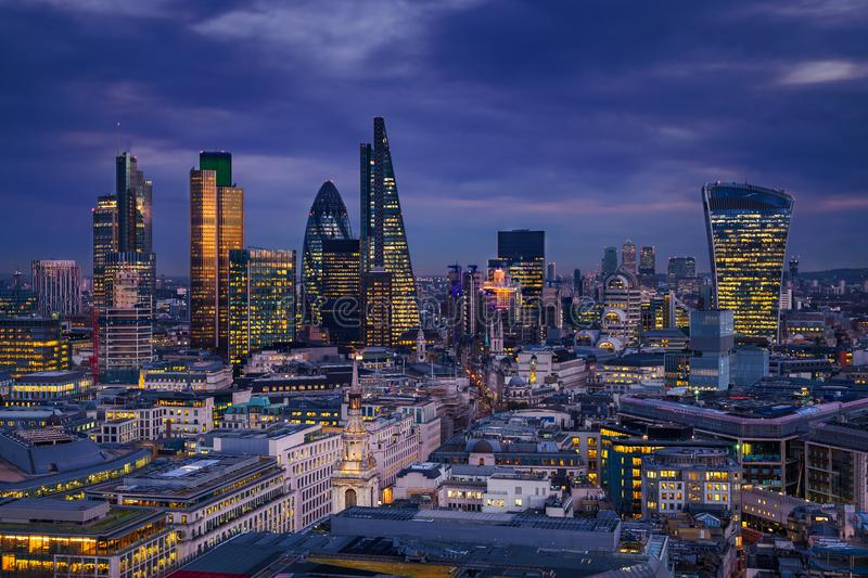 London, England - Panoramic skyline view of Bank district of London with the skyscrapers of Canary Wharf. At the background at blue hour royalty free stock photography