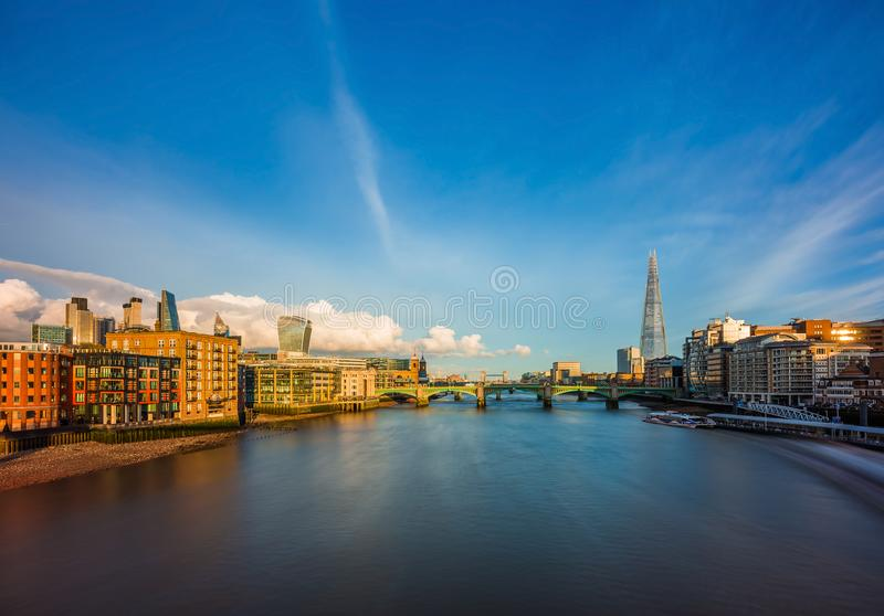 London, England - Panoramic skyline view of central London with skyscrapers of Bank district. Sightseeing boat on River Thames, Tower Bridge and other famous stock photos