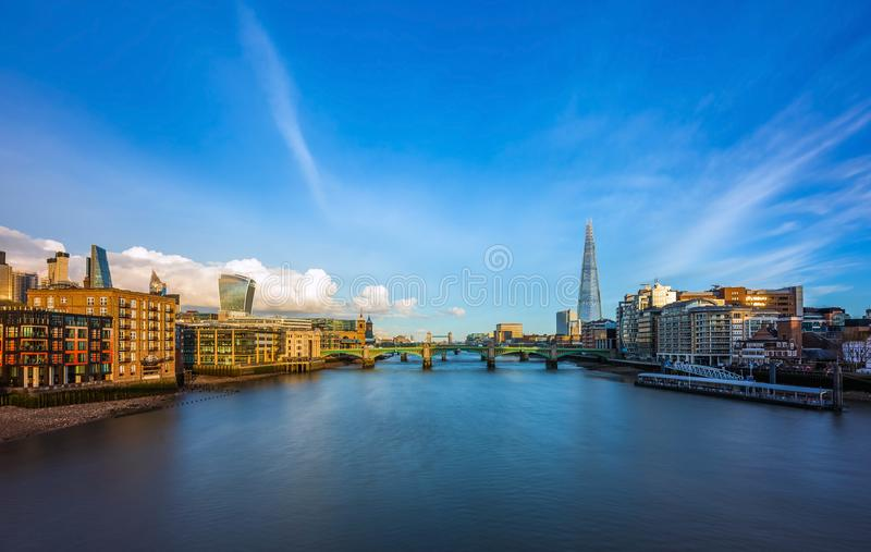 London, England - Panoramic skyline view of central London with skyscrapers of Bank district. River Thames, Tower Bridge and other famous landmarks at sunset stock photography