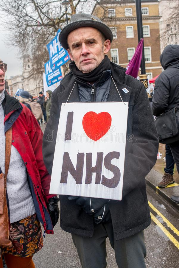 The NHS In Crisis demonstration, in central London, in protest of underfunding and privatisation in the NHS. royalty free stock images