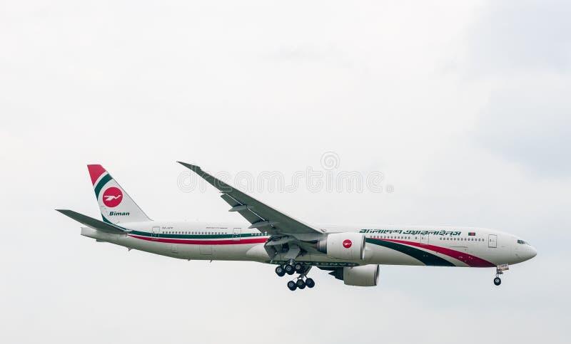 LONDON, ENGLAND - SEPTEMBER 27, 2017: Biman Bangladesh Airlines Boeing 777 S2-AFP landing in London Heathrow International Airport. Biman Bangladesh Airlines stock photo