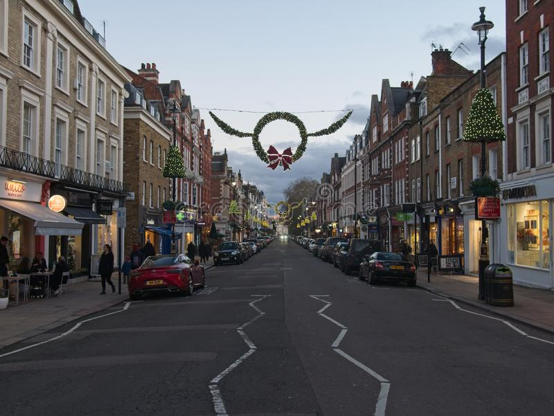 St John`s Wood Hight Street with Christmas decoration in the evening. royalty free stock image