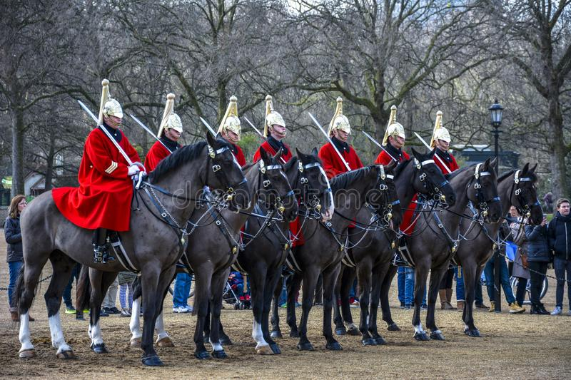 LONDON, England UK - February 15, 2016 : Her Majesty The Queen`s Life Guard Soldiers from the Household Cavalry. On parade during changing of the Guard at Horse royalty free stock photo