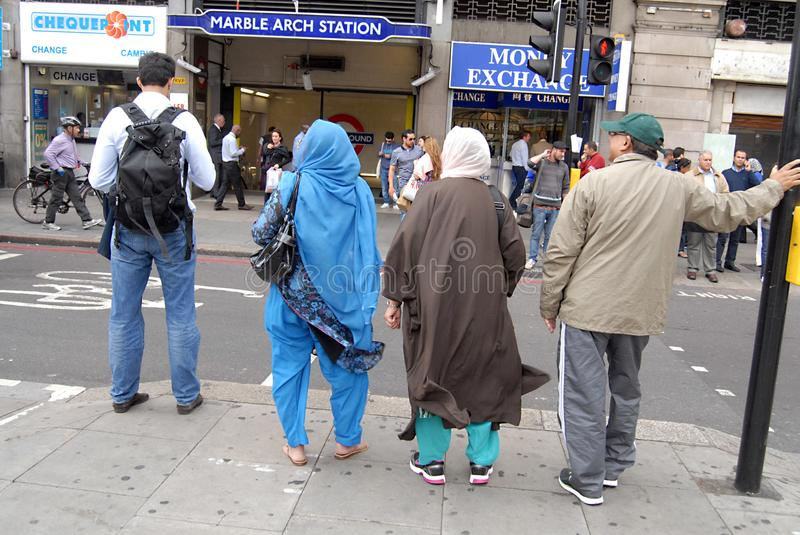 ENGLAND_shoppers on oxford street. LONDON/ ENGLAND /UK _Shopping life on Oxford Street Various nationalies consumer shopping and with shopping bags shopper royalty free stock photo