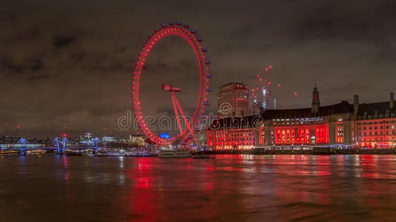 London eye lit with colorful lights at night from the Westminster bridge over river Thames. London, England, United Kingdom - June, 2016. Enjoying a lovely view stock photos