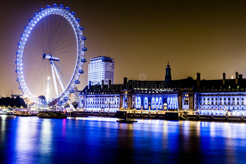 London Eye along the South Bank of River Thames. The London Eye, the Ferris wheel on the South Bank of the River Thames is 135m tall and 120m in diameter stock image