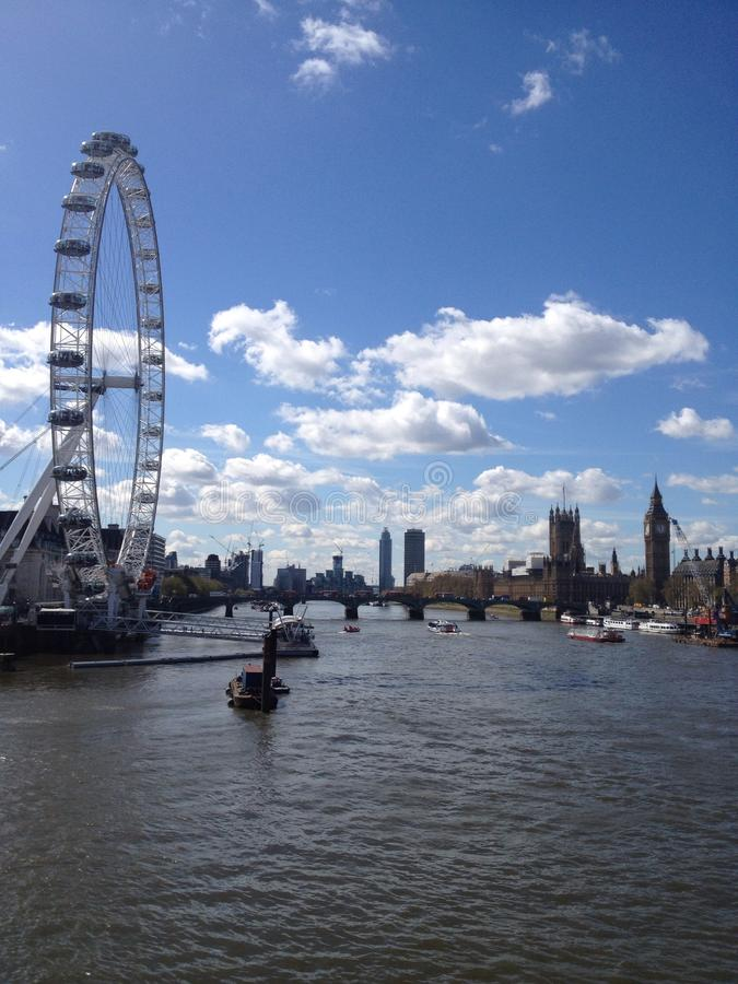 London Eye and Big Ben. Photography of London eye and Big Ben on the Thames royalty free stock photography