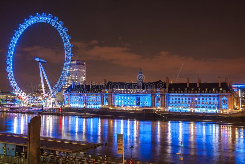 London Eye and County Hall building at night, UK stock image