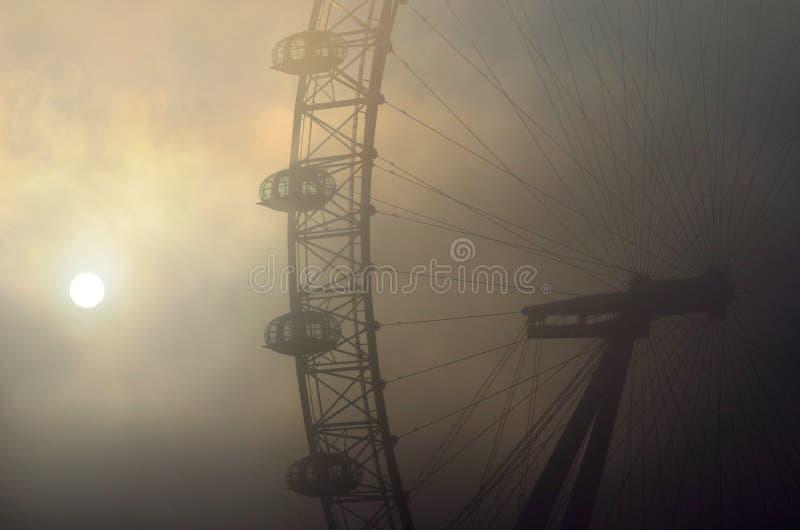 London Eye in the fog stock photo
