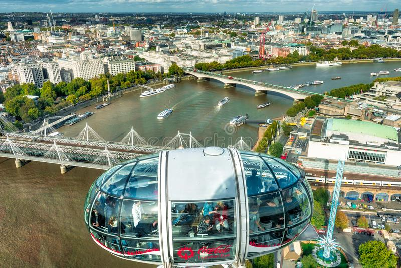 London Eye over Thames. The London Eye is a giant Ferris wheel on the South Bank of the River Thames in London. The structure is 443 feet 135 m tall and the stock photography