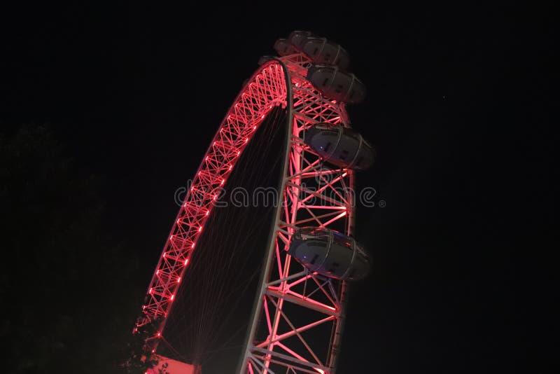 London Eye illuminated at night stock image