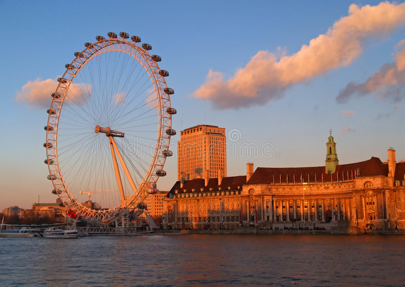The London Eye in London. At sunset stock photo