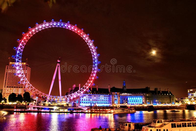 London eye and parliament house by the night lights  royalty free stock images