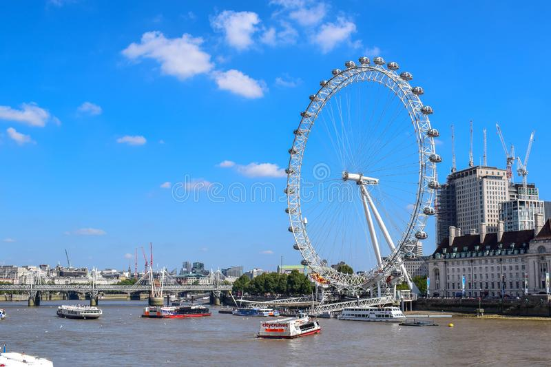 The London Eye on the South Bank of the River Thames in London, England. View of the London Eye located on the South Bank of the River Thames in London, England royalty free stock photography