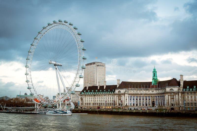 London Eye viewed from the bridge stock photography
