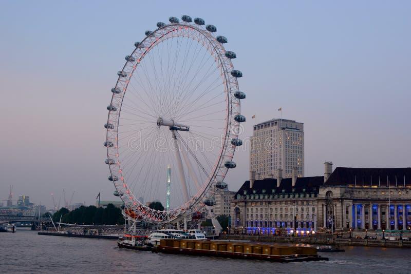 London Eye at Westminster, England. At Dusk stock image