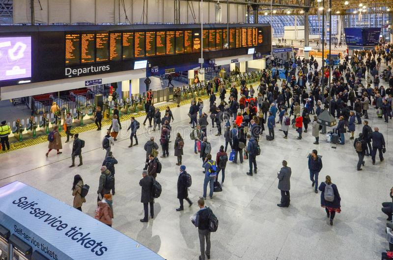 Many people in front of time board in rush hour at Waterloo train station, London, England.Waterloo station, a central stock photography