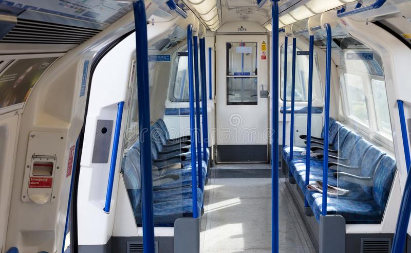 Inside of a metro coach on Februari 22, 2019 in London. London Underground is the 11th busiest metro system. London - Februari 22: Inside of a metro coach on royalty free stock photos