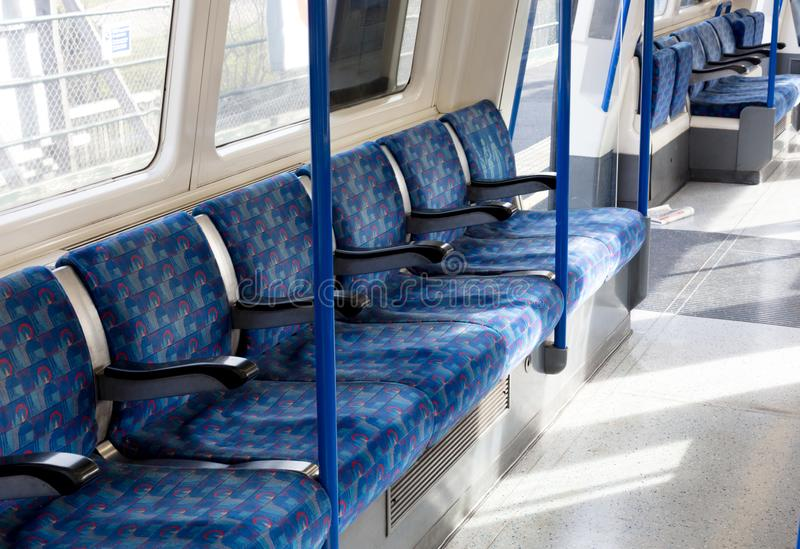 Inside of a metro coach on Februari 22, 2019 in London. London Underground is the 11th busiest metro system. London - Februari 22: Inside of a metro coach on stock photography