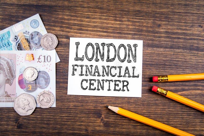 London Financial Center. UK pound,money of United kingdom close-up on wooden background stock photos