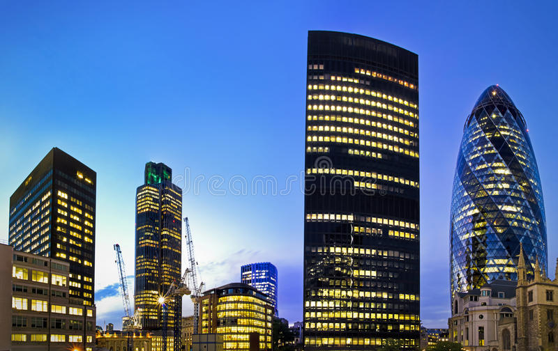 London financial district at twilight. Evening time shot of London's famous skyscrapers including 'the Gherkin', Aviva and Tower 42 in the heart of it's royalty free stock image
