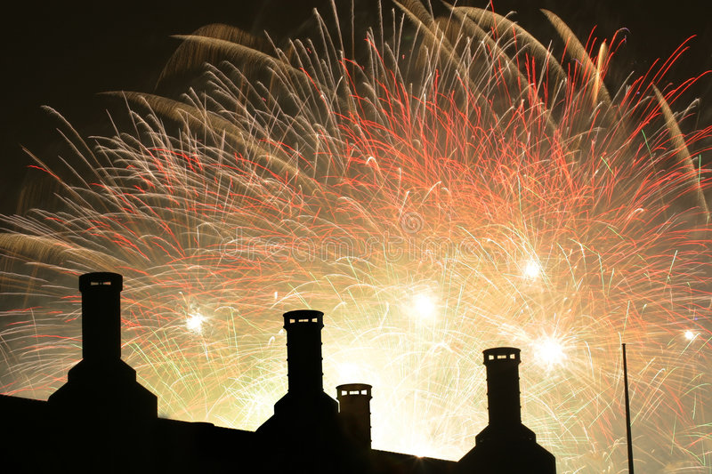 London Fireworks. Over the roof during new year eve royalty free stock image