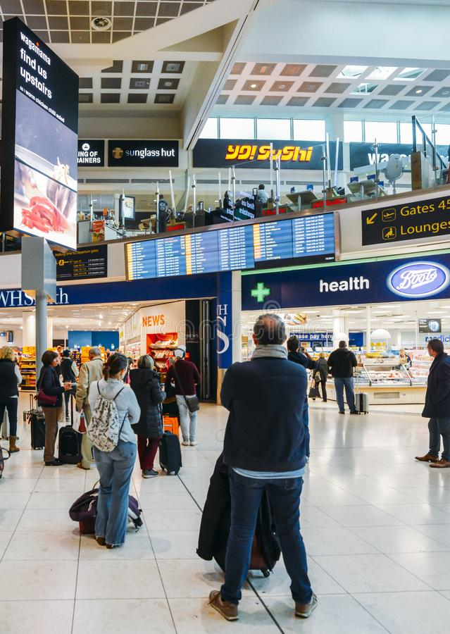 Passengers check their flight information on a digital display at London Gatwick`s North Terminal. Various options to royalty free stock photo