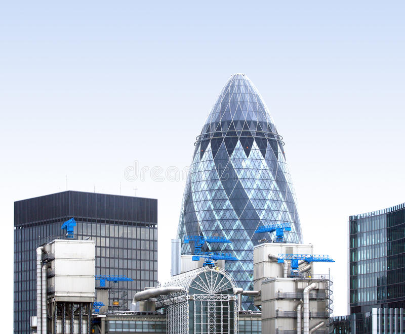 London Gherkin. An unsual view from the London Gherkin with industrial air conditioning systems and big blue cranes royalty free stock image