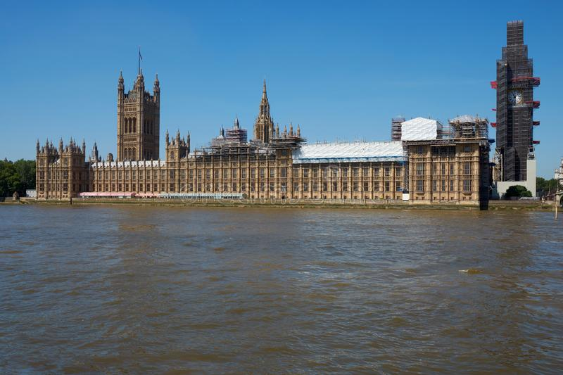 LONDON - June 25, 2018: View of London Parliamen. LONDON / GREAT BIN - June 25, 2018: View of London Parlent with Big Ben in scaffolding above the Thames river royalty free stock image