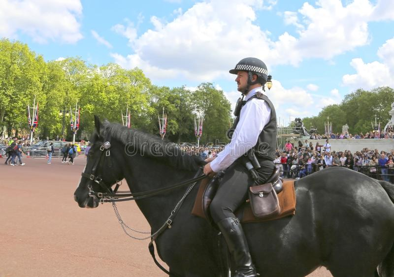 London, Great Britain -May 23, 2016: Mounted police near Buckingham Palace. During the changing of the guard stock images