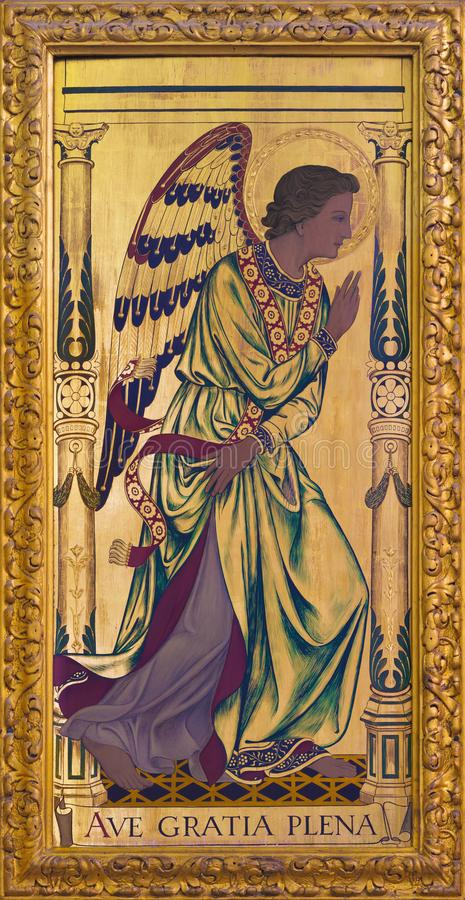 London - The archangel Gabriel as the left part of Annunciation painting on the wood on the altar in church St Clement`s stock photography