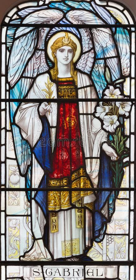 LONDON, GREAT BRITAIN - SEPTEMBER 17, 2017: The archangel Gabriel on the stained glass in church St. Michael, Chester square.  royalty free stock image