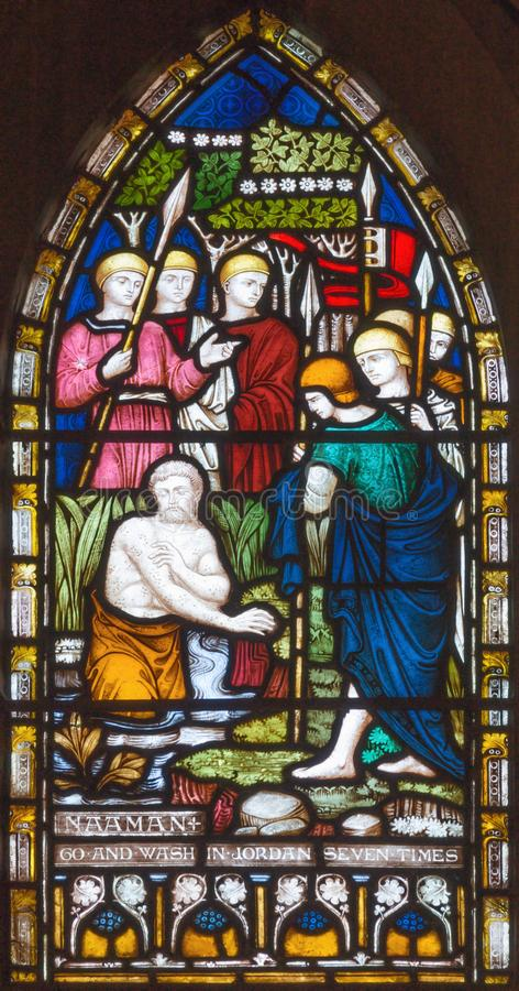 LONDON, GREAT BRITAIN - SEPTEMBER 19, 2017: The Naaman of Syria bathing in Jordan on the stained glass in St Mary Abbot`s. Church on Kensington High Street stock images