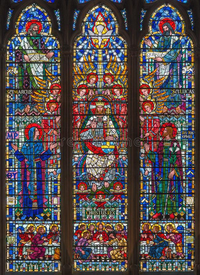 London - The stained glass of Jesus Christ the Pantokrator, Virgin Mary, St. Joseph and the Evangelists in church St Etheldreda royalty free stock images