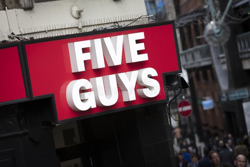 London, Greater London, United Kingdom, 7th February 2018, A sign and logo for Five Guys stock photos