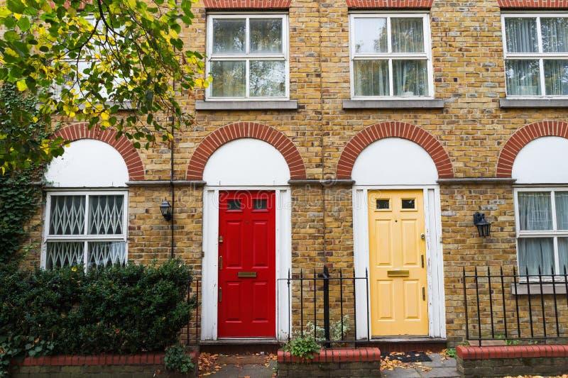 London house traditional brick wall facade and doors, UK royalty free stock photo