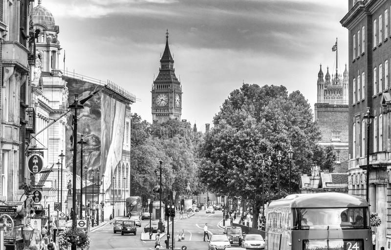 LONDON - JULY 1, 2015: Traffic in Westminster area. London attra. Cts 30 million people every year royalty free stock photography