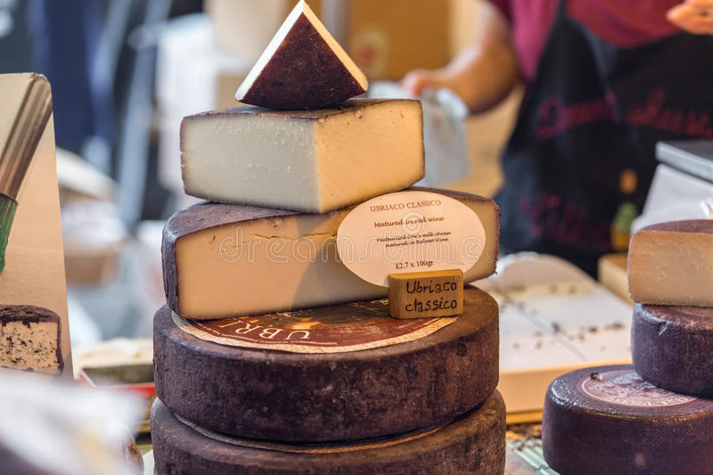 LONDON - JUN 12, 2015: Cheese shop in London. A variety of cheeses for sale at Borough Market in London, United Kingdom. royalty free stock images
