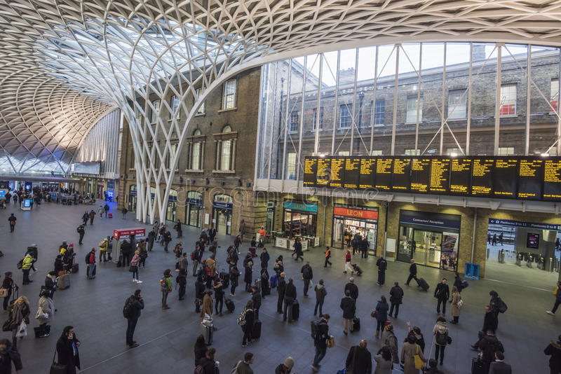 London Kings Cross station with commuters traveling to work. LONDON, ENGLAND - JANUARY 26th 2017: London commuters travel through Kings Cross train station on stock photography