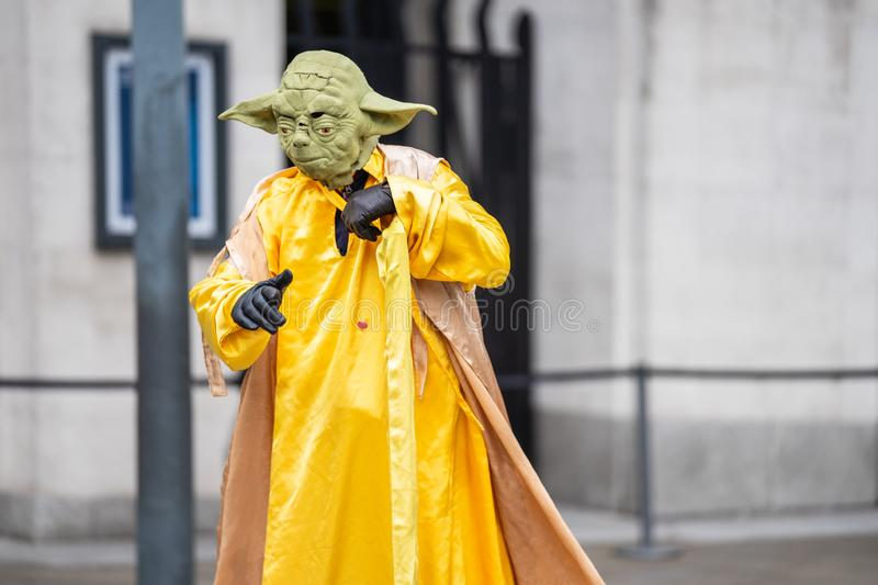 London, Londons West End in the City of Westminster, UK, July, 2019. Piccadilly circus. Floating yoda. Street artist stock images