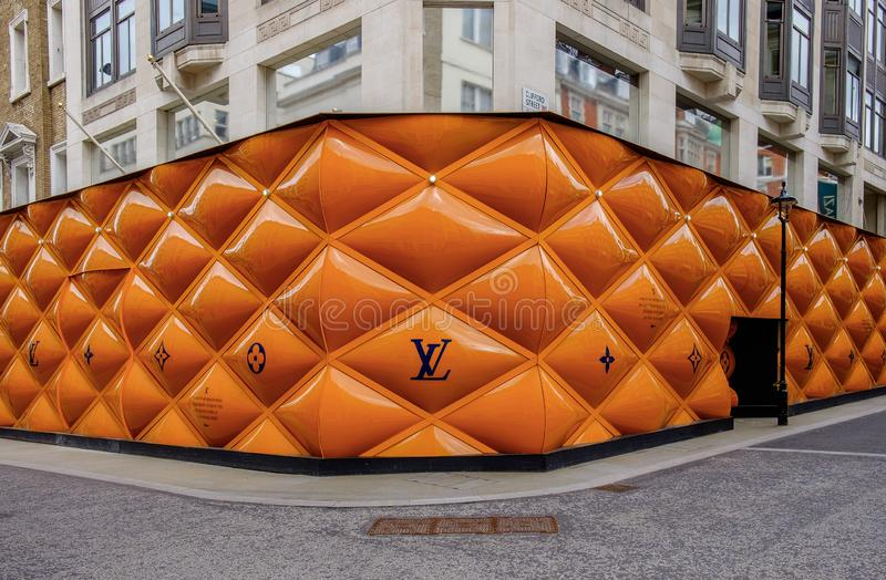 London-LV Building Site Fence Panels-3. London, U.K, March 2019, building site fence panel for a Louis Vuitton shop in the Mayfair area stock images