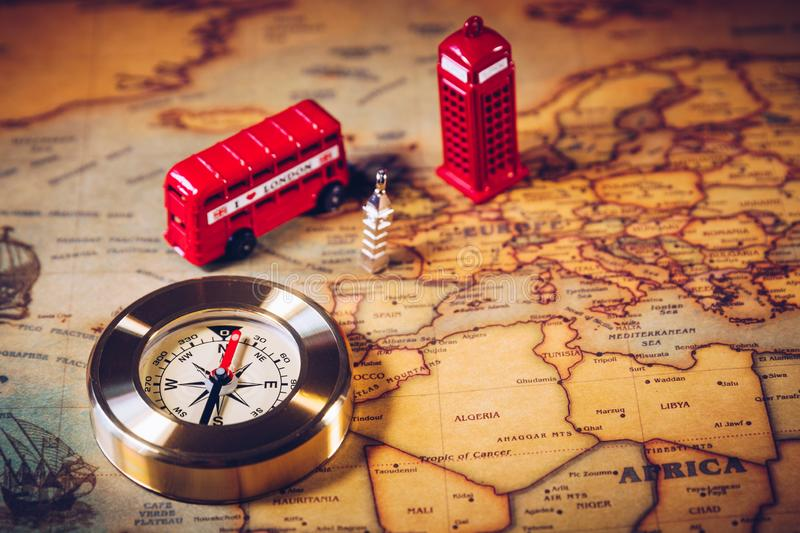 London map with Big Ben, double decker bus in miniature and compass, travel concept. England, UK stock images